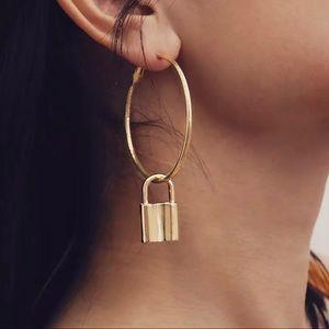 Gold hoop earrings with lock
